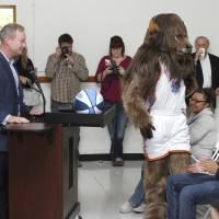 Photo - Thunder mascot Rumble and Oklahoma City Mayor Mick Cornett participate in a school assembly celebrating the MAPS for Kids renovation of Emerson High School on Friday.
