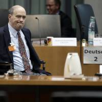 Photo - The former  US National Security Agency, NSA, employee William Binney, in wheelchair, arrives for his questioning by the German parliamentary NSA investigation committee in Berlin, Germany, Thursday, July 3, 2014. Picture taken trough a window. The committee investigates  the NSA  surveillance  activities, that also included the tapping of German Chancellor Angela Merkel. (AP Photo/Michael Sohn)