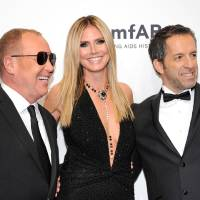 Photo - Designer Michael Kors, left, poses with honorees Heidi Klum and Kenneth Cole at amfAR's New York gala at Cipriani Wall Street on Wednesday, Feb. 6, 2013 in New York. (Photo by Evan Agostini/Invision/AP)