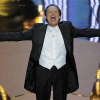 Photo - Billy Crystal performs during the 84th Academy Awards on Sunday, Feb. 26, 2012, in the Hollywood section of Los Angeles. (AP Photo/Mark J. Terrill)