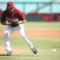Photo - The Arizona Diamondbacks' Wade Miley fields during a drill as his team trains at the Sydney Cricket Ground in Sydney, Wednesday, March 19, 2014. The MLB season-opening two-game series between the Los Angeles Dodgers and Arizona Diamondbacks in Sydney will be played this weekend. (AP Photo/Rick Rycroft)