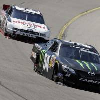 Photo - Sam Hornish Jr. leads Ryan Blaney, left, during the NASCAR Nationwide auto race, Sunday, May 18, 2014, at Iowa Speedway in Newton, Iowa. (AP Photo/Charlie Neibergall)