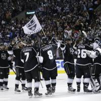 Photo - The Los Angeles Kings celebrate their team's 2-1 win against the St. Louis Blues after Game 6 of a first-round NHL hockey Stanley Cup playoff series in Los Angeles, Friday, May 10, 2013. (AP Photo/Jae C. Hong)