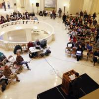 Photo - Concerned people listen Saturday as Oklahoma American Civil Liberties Union Director Ryan Kiesel speaks during a 4th Amendment rights rally in the rotunda of the state Capitol. Photos by Paul Hellstern, The Oklahoman
