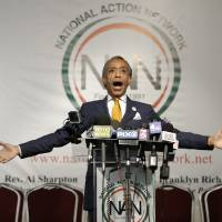 Photo - Rev. Al Sharpton speaks during a news conference in New York, Tuesday, April 8, 2014. Sharpton says a report that he spied on New York mafia figures for the FBI in the 1980s is old news. (AP Photo/Seth Wenig)