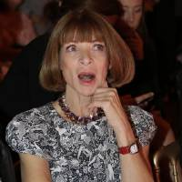 Photo -   Vogue editor in chief Anna Wintour reacts as she attends the Versace women's Fall-Winter 2012-2013 collection that was presented in Milan, Italy, Friday Sept. 21, 2012.(AP Photo/Luca Bruno)