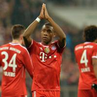 Photo - Bayern's David Alaba of Austria, center, reacts to supporters after the German first division Bundesliga soccer match between  FC Bayern Munich and FC Schalke in Munich, Germany, on Saturday, March 1,  2014. Bayern won 5-1. (AP Photo/Kerstin Joensson)
