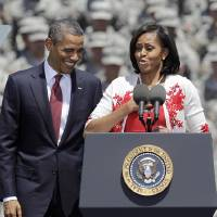 Photo -   First lady Michelle Obama introduces President Barack Obama at the Fort Stewart Army post, Friday, April 27, 2012, in Fort Stewart, Ga. (AP Photo/David Goldman)