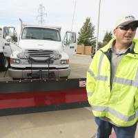 Photo - Driver Travis Roebuck talks about driving a snowplow Nov. 15 for the North Texas Tollway Authority in Plano, Texas.  AP Photo