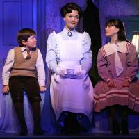 Photo - FILE - This file theater publicity image provided by Disney Theatricals shows, from left, Neil McCaffrey, Scarlett Strallen and Cassady Leonard in a scene from