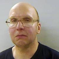 Photo - This April 2013 booking photo released by the Kennebec County Sheriff's Office in Augusta, Maine, shows Christopher Knight, arrested Thursday, April 4, 2013, while stealing food from a camp in Rome, Maine.  Authorities said Knight, known as the North Pond Hermit and who lived for 27 years in the woods of central Maine, may be responsible for more than 1,000 burglaries.  (AP Photo/Kennebec County Sheriff's Office)