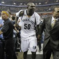 Photo - Memphis Grizzlies forward Zach Randolph (50) leaves the court after the Grizzlies beat the San Antonio Spurs in Game 6 of a first-round NBA basketball series on Friday, April 29, 2011, in Memphis, Tenn. Randolph scored 31 points as the Grizzlies won 99-91 to win the series 4-2. (AP Photo/Mark Humphrey) ORG XMIT: TNMH127