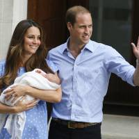 Photo - FILE - In this July 23, 2013 photo, Britain's Prince William, right, and Kate, Duchess of Cambridge, hold the Prince of Cambridge, as they pose for photographers outside St. Mary's Hospital exclusive Lindo Wing in London where the Duchess gave birth on July 22.  Britain's Prince William has described his joy at introducing newborn son to the world on the steps of a London hospital last month  and about his nerves about fitting the car seat securely into the Land Rover before driving off.  (AP Photo/Kirsty Wigglesworth, File)
