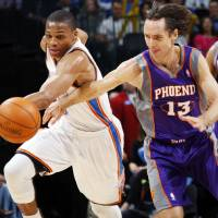 Photo - Oklaoma City's Russell Westbrook (0) takes the ball from Steve Nash (13) of Phoenix during the NBA basketball game between the Oklahoma City Thunder and Phoenix Suns at Chesapeake Energy Arena in Oklahoma City, Saturday, Dec. 31, 2011. Photo by Nate Billings, The Oklahoman