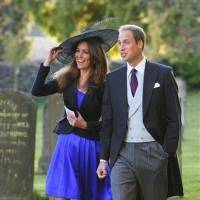 Photo - FILE - In this Oct. 23, 2010 file photo, Britain's  Prince William and Kate Middleton leave the wedding of their friends Harry Mead and Rosie Bradford in the village of Northleach, England. (AP Photo/Chris Ison, pa , file)