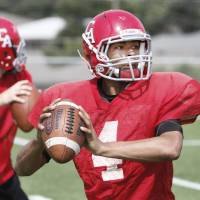 Photo - CARL ALBERT HIGH SCHOOL FOOTBALL / SPRING FOOTBALL: Carl Albert's Dillan Dansby throws to a receiver during a morning workout in Midwest City, Oklahoma , Monday, May 23, 2011. Photo by Steve Gooch ORG XMIT: KOD