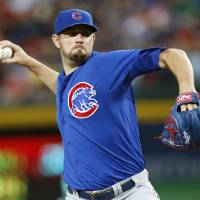 Photo - Chicago Cubs starting pitcher Jason Hammel delivers a pitch in the first inning of a baseball game against the Atlanta Braves, Friday, May 9, 2014, in Atlanta. (AP Photo/John Bazemore)