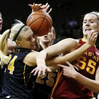 Photo - Iowa State center Anna Prins (55) draws a foul on Iowa guard Jaime Printy (24) as they battle for a rebound during the first half an NCAA college basketball game Thursday, Dec. 6, 2012 at Carver-Hawkeye Arena in Iowa City, Iowa.  (AP Photo/The Gazette,Brian Ray)