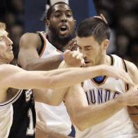 Photo - Oklahoma City's Nick Collison (4) and D.J. White fight  for the ball against San Antonio's Matt Bonner (15) during the NBA basketball game between Oklahoma City Thunder and San Antonio Spurs, Tuesday April 7, 2009, at the Ford Center in  Oklahoma City. Photo by Brenda O'Brian. The Oklahoman ORG XMIT: KOD