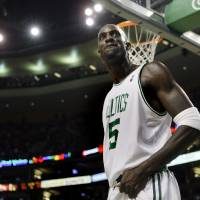 Photo - Boston Celtics' Kevin Garnett reacts after blocking an Indiana Pacers shot during the second half of an NBA basketball game in Boston on Wednesday, Dec. 3, 2008. The Celtics won 114-96. (AP Photo/Elise Amendola)  ORG XMIT: MAEA112