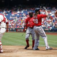 Photo - Washington Nationals' Anthony Rendon, from right, Jayson Werth, center, and Denard Span, left, celebrate behind Philadelphia Phillies catcher Cameron Rupp after Werth's three-run home run during the first inning of a baseball game, Sunday, July 13, 2014, in Philadelphia. (AP Photo/Matt Slocum)