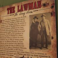 Photo - The role of  lawman Stringer Fenton is explained on a panel in the exhibit. Photo by David McDaniel, The Oklahoman  David McDaniel - The Oklahoman
