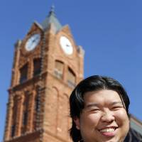 Photo - Malaysian UCO student Joshua Lim poses for a photo in front of Old North on the campus of the University of Central Oklahoma in Edmond, Okla., Monday, Nov. 12, 2012. Photo by Nate Billings, The Oklahoman