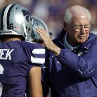Photo -   In this photo taken Saturday, Sept. 1, 2012, Kansas State coach Bill Snyder pats the helmet of place kicker Brandon Klimek (6) before an NCAA college football game against Missouri State in Manhattan, Kan. Snyder desperately wanted No. 22 Kansas State to start fast in its season opener. Didn't happen. So, he figures, perhaps he'll just make sure the Wildcats finish strong. After all, that's what helped them beat Miami _ this Saturday's opponent _ with a dramatic goal line stand last year. (AP Photo/Orlin Wagner)