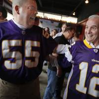 Photo -   Craig Danzl, left, talks with Minnesota Gov. Mark Dayton as Minnesota Vikings fans gathered Sunday, May 6, 2012, at Mac's Industrial Sports Bar in Minneapolis. The state legislature is scheduled to vote Monday on a $1 billion Vikings stadium bill. (AP Photo/Star Tribune, Richard Tsong-Taatarii) ST. PAUL OUT MINNEAPOLIS-AREA TV OUT MAGS OUT