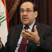 Photo - File -- In this Saturday, Dec. 3, 2011 file photo, Iraq's Shiite Prime Minister Nouri al-Maliki is seen during an interview with The Associated Press in Baghdad, Iraq. In results announced Monday, May 19, 2014, State of Law, a coalition led by Al-Maliki has emerged as the biggest winner in the country's April 30 parliamentary elections. Al-Maliki must now reach out to other blocs to try to cobble together a ruling coalition. That process could take months. (AP Photo/Hadi Mizban, File)