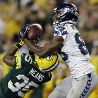 Photo - Seattle Seahawks' Stephen Williams (83) catches a touchdown pass over Green Bay Packers' Loyce Means during the second half of an NFL preseason football game Friday, Aug. 23, 2013, in Green Bay, Wis. (AP Photo/Tom Lynn)