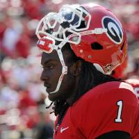 Photo -   FILE - In this Sept. 10, 2011, file photo, Georgia running back Isaiah Crowell look son before a NCAA college football game against South Carolina in Athens, Ga. Crowell faces felony weapons charges after police found a gun in his vehicle early Friday morning, June 29, 2012. Athens-Clarke Police Department spokeswoman Hilda Sorrow says Crowell was arrested at a vehicle checkpoint on the UGA campus at around 2:20 a.m. Among the charges he faces are carrying a concealed weapon and possession of a weapon on school property. (AP Photo/John Amis, File)