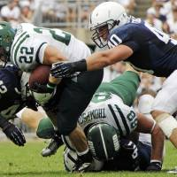Photo -   Ohio running back Beau Blankenship (22) is brought down by Penn State linebackers Michael Mauti (42) and Glenn Carson (40) after a short gain during the fourth quarter of an NCAA college football game at Beaver Stadium in State College, Pa., Saturday, Sept. 1, 2012. Ohio won 24-14. (AP Photo/Gene J. Puskar)