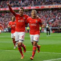 Photo - Benfica's Lima, right, celebrates with teammate Rodrigo after scoring the opening goal during their Portuguese league soccer match with Academica Sunday, March 23 2014, at Benfica's Luz stadium in Lisbon. (AP Photo/Armando Franca)