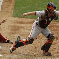 Photo -   San Francisco Giants' Buster Posey (28) takes a throw wide of home plate as Arizona Diamondbacks' Aaron Hill slides in to score during the seventh inning in an MLB baseball game Sunday, April 8, 2012, in Phoenix.(AP Photo/Ross D. Franklin)