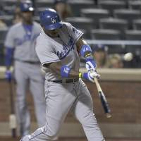Photo - Los Angeles Dodgers right fielder Yasiel Puig (66) connects for a double against the New York Mets during the sixth inning of a baseball game, Tuesday, May 20, 2014, in New York. (AP Photo/Julie Jacobson)