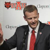 Photo - FILE - In this Dec. 12, 2012 file photo, Arkansas State head coach Bryan Harsin speaks during an NCAA college football news conference in Jonesboro, Ark. A person familiar with the decision tells The Associated Press that Boise State has hired  Harsin as its next coach. The person spoke on condition of anonymity because the move had not become official.  (AP Photo/Danny Johnston, File)