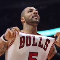 Photo -   Chicago Bulls power forward Carlos Boozer reacts after a foul call during Game 5 in an NBA basketball first-round playoff series, in Chicago on Tuesday, May 8, 2012. The Bulls won 77-69.(AP Photo/Daily Herald, John Starks)