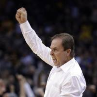 Photo - FILE - In this Jan. 23, 2013, file photo, Golden State Warriors co-owner  Joe Lacob celebrates as the Warriors score during the final seconds of an NBA basketball game against the Oklahoma City Thunder in Oakland, Calif. Booed one year and celebrated the next, Lacob admits he feels