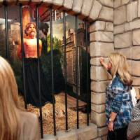 Photo - Three women watch and listen to an animatronic character describe his role in connection to the history of the Bible as partof the