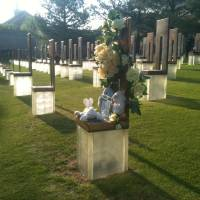 Photo - Flowers and stuffed animals on a chair at the Oklahoma City National Memorial Tuesday morning - Photo by John Clanton