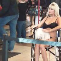 Photo - Tammy Banovac, 52, clad in undergarments and sitting in a wheelchair, failed to pass the Transportation Security Administration screening process Tuesday when security officers detected traces of nitrates on her wheelchair. Frame grab from video by John Maringouin