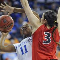 Photo - Kentucky center DeNesha Stallworth (11) shoots as Georgia's Anne Marie Armstrong (3) defends during the first half of an NCAA college basketball game in the Southeastern Conference women's tournament, Saturday, March 9, 2013, in Duluth, Ga. (AP Photo/John Amis)