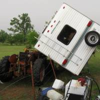 Photo - STORM / TORNADO / DAMAGE: This camper was blown onto  a tractor near 120th Avenue  and Maguire Road in Norman.  PHOTO BY JAMES TYREE,  THE OKLAHOMAN     ORG XMIT: 1005110011333938