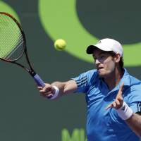 Photo - Andy Murray, of Great Britain, returns to Feliciano Lopez, of Spain, at the Sony Open tennis tournament in Key Biscayne, Fla., Sunday, March 23, 2014. (AP Photo/Alan Diaz)