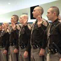 Photo - Thirty Oklahoma Highway Patrol troopers take the oath during their graduation Friday at True Vine Baptist Church in Oklahoma City. This is the first class in more than three years. Photo By David McDaniel, The Oklahoman