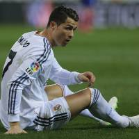 Photo - Real's Cristiano Ronaldo on the turf during a semi final, 2nd leg, Copa del Rey soccer match between Atletico de Madrid and Real Madrid at the Vicente Calderon stadium in Madrid, Spain, Tuesday, Feb. 11, 2014. (AP Photo/Andres Kudacki)