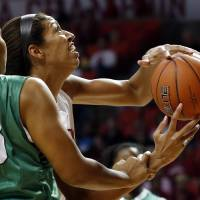 Photo - Oklahoma's Nicole Griffin (4) shoots and is fouled by North Texas' Alexis Hyder (33) as the University of Oklahoma Sooners (OU) play the North Texas Mean Green in NCAA, women's college basketball at The Lloyd Noble Center on Thursday, Dec. 6, 2012  in Norman, Okla. Photo by Steve Sisney, The Oklahoman