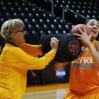 Photo - Tennessee head coach Holly Warlick works with forward Cierra Burdick (11) during practice for the NCAA women's college basketball tournament Friday, March 21, 2014, in Knoxville, Tn. (AP Photo/John Bazemore)