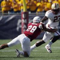 Photo - Massachusetts defensive back Jackson Porter (28) tackles Boston College running back Myles Willis (23) during the second quarter of an NCAA college football game in Foxborough, Mass., Saturday, Aug. 30, 2014. Boston College won 30-7. (AP Photo/Michael Dwyer)